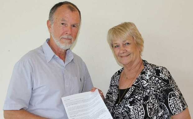 HOT TOPIC: Chair of the WRA's election advisory committee Andrew Marshall with council candidate Jan Clifford and a copy of Jan's completed questionnaire.