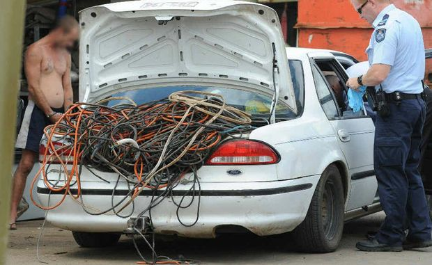 Police go over a car load of wire at a Steptoe St address in Bundaberg East.
