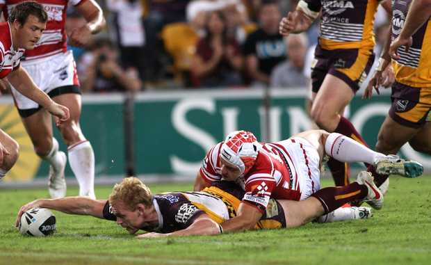 Peter Wallace of the Broncos scores a try during the round five NRL match between the Brisbane Broncos and the St George Illawarra Dragons at Suncorp Stadium