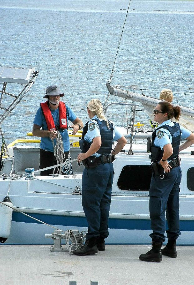 Yacht skipper Ken Hogan speaks to police after a tow to the Lance Ferris Wharf.