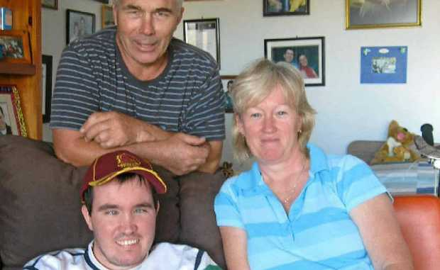 Chris Hibberd was diagnosed with Batten Disease in 1994, here with dad Garry and mum Helen.