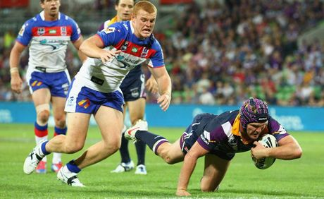 Todd Lowrie of the Storm scores a try during the round five NRL match between the Melbourne Storm and the Newcastle Knights at AAMI Park