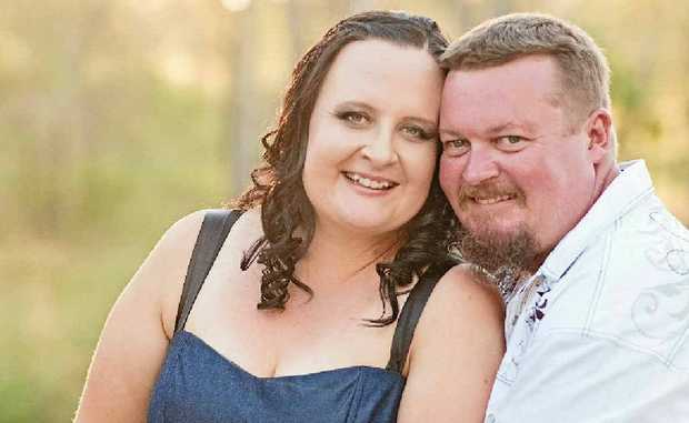 """Louise Simpson and Ross Braddock say """"I do""""."""