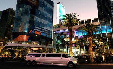 A stretch limo cruises the Las Vegas Strip.
