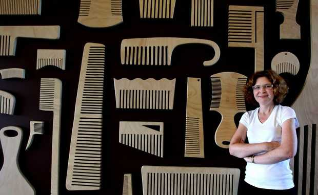 Sherrie Knipe in front of some of her oversized combs.