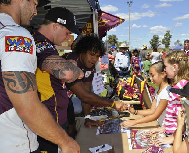 Broncos captain Sam Thaiday signs an autograph for a fan. The Brisbane team will pay a visit to Ipswich on Thursday.