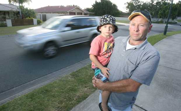 Ross Dionysius with his son Rhys outside the Winston Glades Early Education Centre. Ipswich City Council is looking to introduce 40km/ph speed limits outside childcare centres in the region. Photo: Rob Williams / The Queensland Times