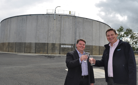 CHEERS: Logan City councillor Luke Smith and Allconnex Water CEO Andrew Foley at the New Bieth water reservoir.