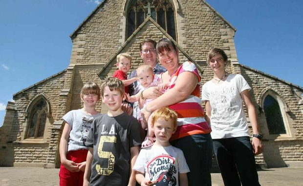 Graham and Sandi Lentell celebrate Easter Sunday with their children, from left, Katelynn (7), Harrison (6), Mitchell (2), Temperance (5 months), Chandler (3) and Alex (15) after the service at St Paul's Anglican Cathedral.