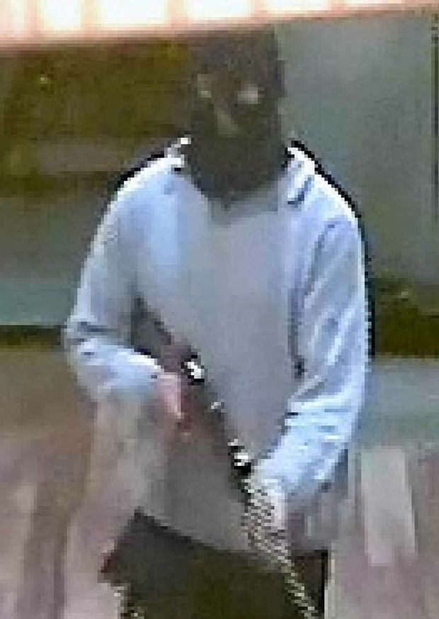 An armed robber who could injure workers.