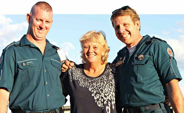 Queensland Ambulance Service's Colin Salter and Jon Ferguson with Capella resident Diana Morris.