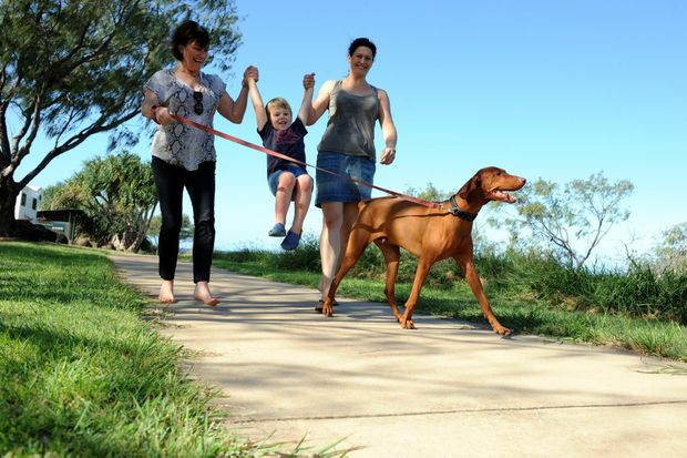 Denise Powell, Nicholas Lacy, Catherine Hackney and Ziggy enjoy a walk along the esplanade.