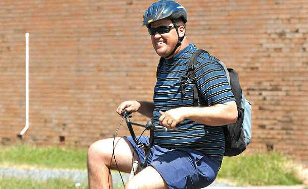 Gregory Weller says riding his unusual bike keeps him fit and healthy. He uses it regularly to run errands and get to work.