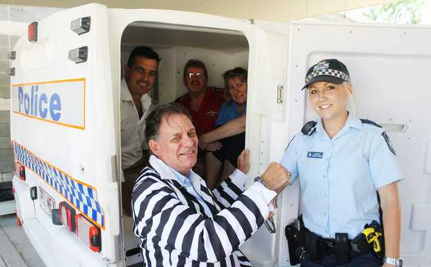 IN LOCK-UP: Whitsunday business people George Wade, Rob Taylor, Steve McDonald and Leanne Abernethy with Whitsunday Police Station constable Lauren Johnson in preparation for the charity fundraiser Time for Kids. Photo Aimee Vinci / Whitsunday Times
