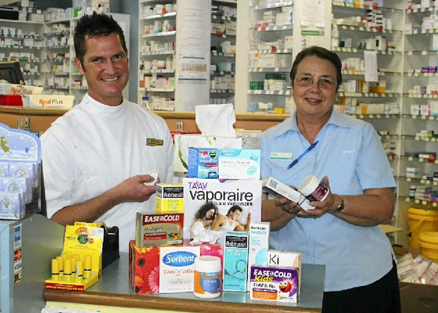 Matthew Date and Lynette Washbourne of John Duggan Chemist stock up on cold and flu relief as the sick season approaches.