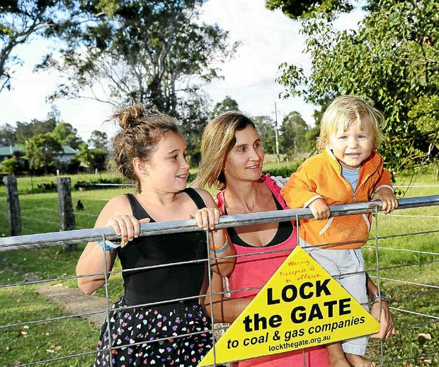 Lilly, Jess, and Norman Coleman, of Tucabia, with their anti-CSG Lock the Gate sign.