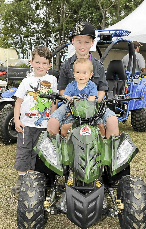 James, Riley and Nate Harney of Childers try out a Grudge Quad Bike at Agro Trend.