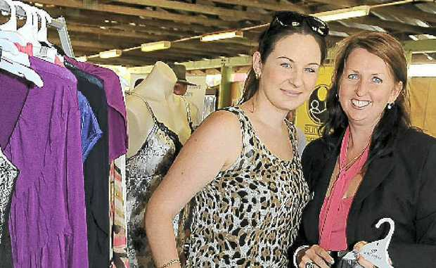 Hannah Maughan is assisted by UnderCoverWear manager Julie Pratt at the expo.