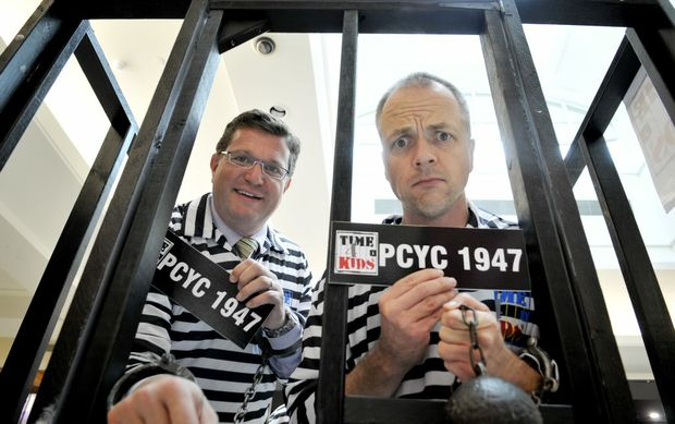 Trevor Watts (left) and CFM's Hamish Carter got locked up this morning for PCYC's Time 4 Kids fundraiser.