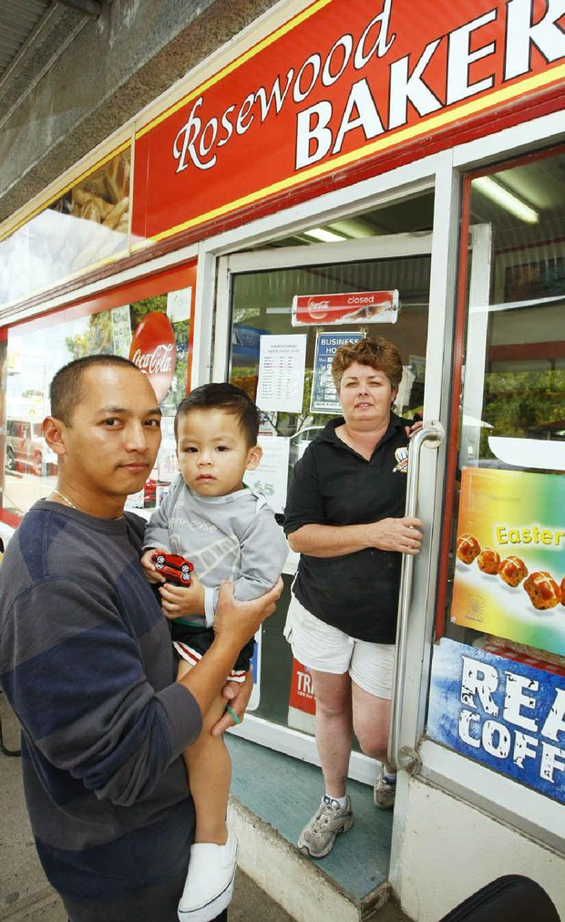 Bakery owner Sherwin Regoso, with son Ryan, 2, and manager Suzie Mellor want more police in town. Photo: David Nielsen
