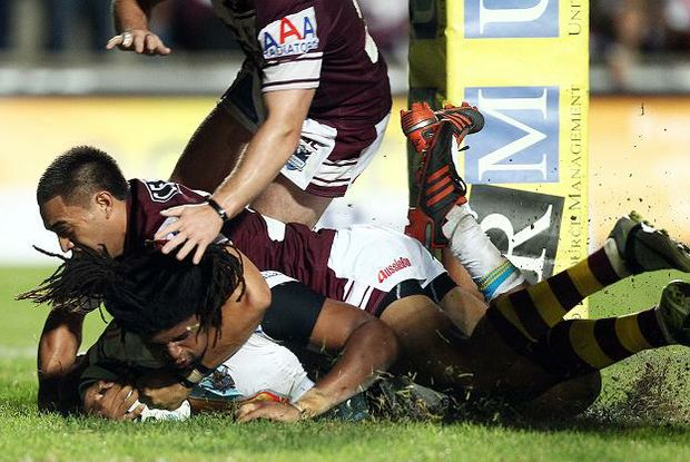Jamal Idris of the Titans scores a try during the round seven NRL match between the Manly Sea Eagles and the Gold Coast Titans at Brookvale Oval