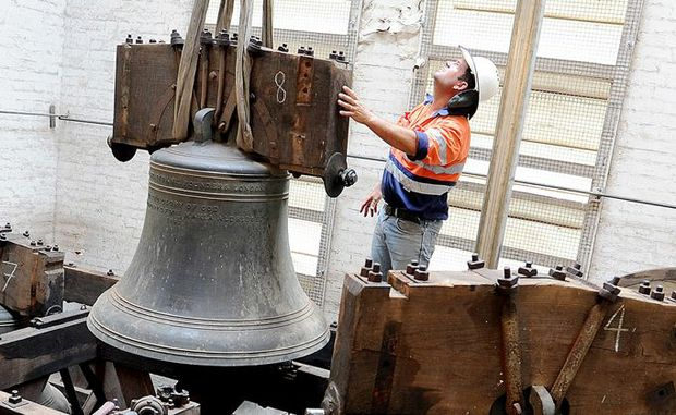 UP AND AWAY: A team of workers used a crane to remove the 125-year-old bells from St Paul's Anglican Church so they could be sent for repair in England.
