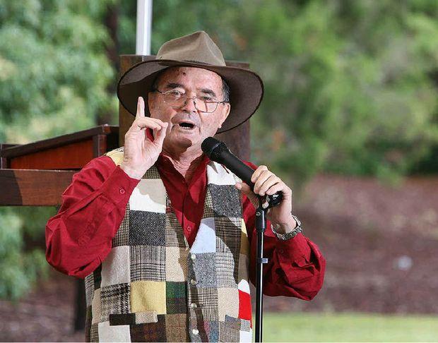 Noel Stallard performs during the Ipswich Poetry Feast Poet's Breakfast at Henry Lawson Bicentennial Park in Walloon yesterday.