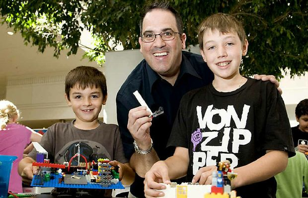 Certified Lego professional Ryan McNaught (centre) helps Brayden (left) and James Powls at a Lego workshop at Clifford Gardens.