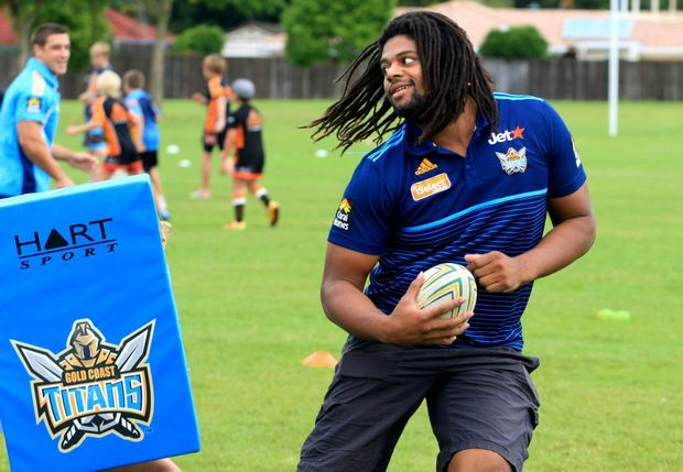 Jamal Idris is king of the kids at Banora Point High School during a Titans coaching clinic.