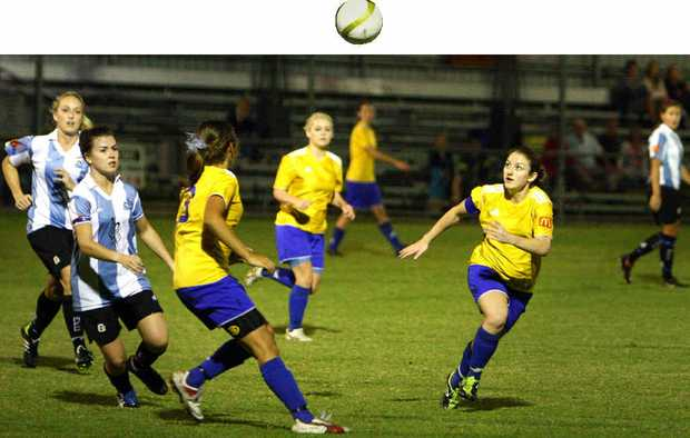 Kylie Rayson watches as the ball comes back to earth.