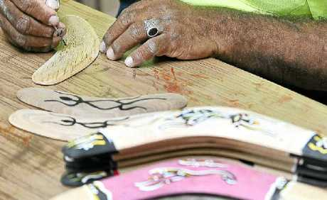 In Kyogle, Wayne Walker is making boomerangs.