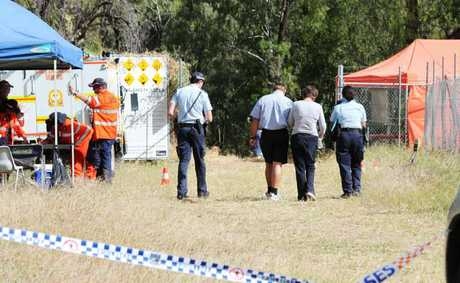 Relatives of missing kayaker Michael Barnes are escorted by Emerald police to the Selma Weir search site.