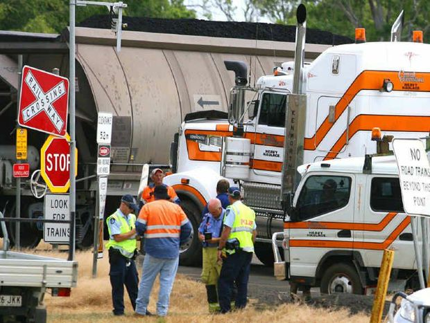 A truck and a passing coal train endured a minor collision at the Malchi-Nine Mile Rd level crossing near Gracemere yesterday, just weeks after a spate of serious near-miss incidents.