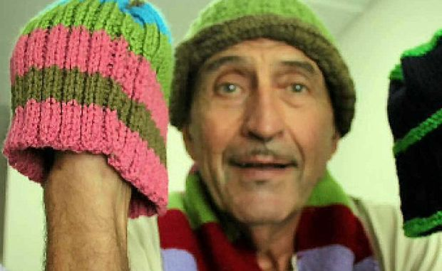 John Felton sends off the latest load of beanies knitted by residents of Akooramak.