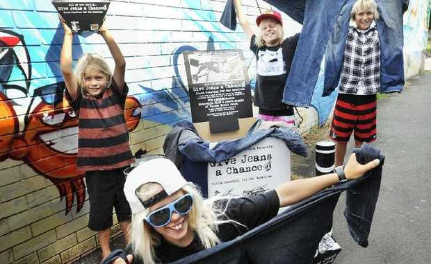 Kyuss King, 11, with friends, from left: Rasmus King, 6, Tai Daniels, 12, and Finn Crisp, 13, all of Byron Bay, support the charity initiative Give Jeans A Chance.