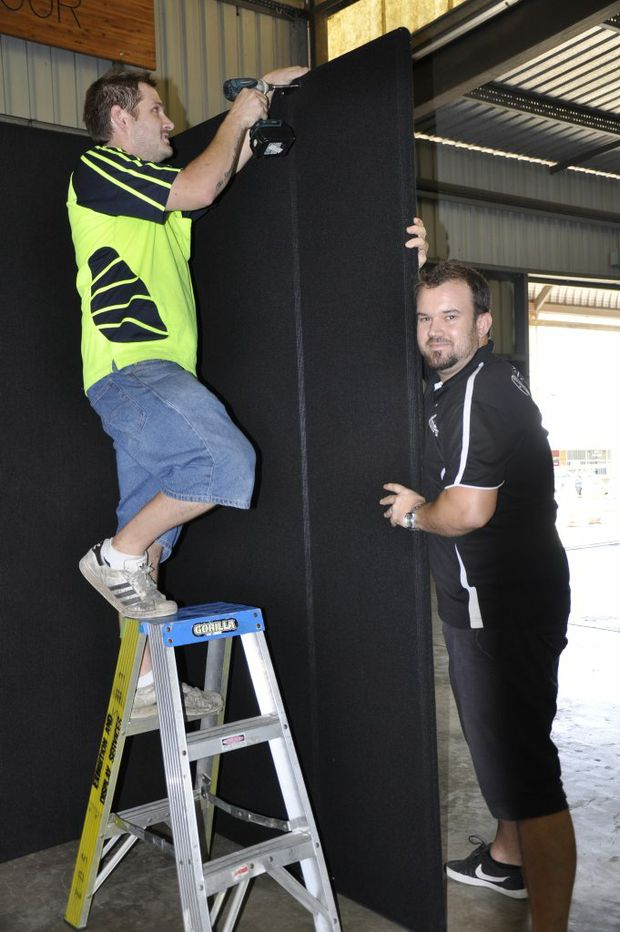 Exhibition display service workers Luke Ragen (left) and Tim Worthington put up the partitions for this weekend's Toowoomba Autumn Home Show.