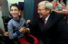 Kevin Rudd speaks with 11-year-old Kyle Sculley.