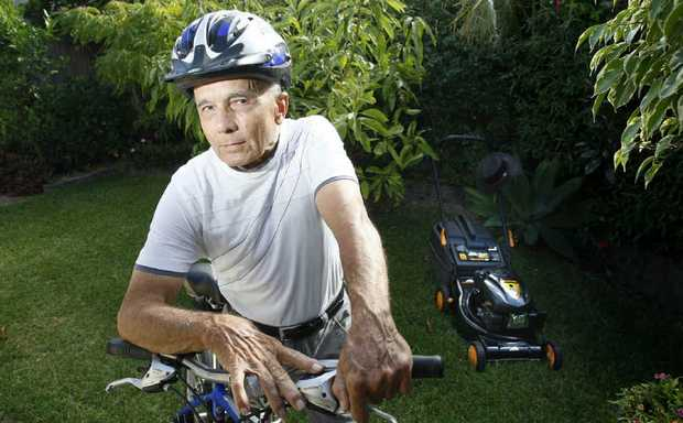 MONEY SPINNER: At 74 years of age, Mal Hand mows lawns to raise funds for the Ride to Conquer Cancer in August.