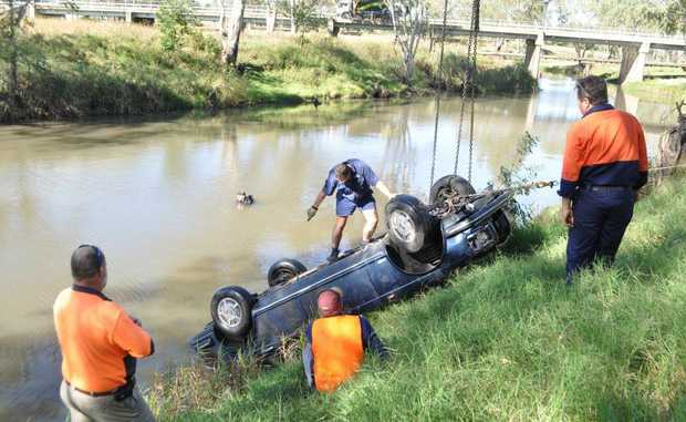 Warwick Tilt Tray Towing and Bellingham's Crane Hire along with diver Pat Windle worked to retrieve the navy blue Bentley from the river near McCahon Bridge. Photo Georja Ryan / Warwick Daily News