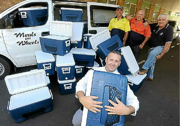 Damien Usher happily receives the kind donation of 33 food-grade cooler boxes from Citizens Who Care representatives Rob Bauer and Steve McCormack, and from Sir Augustus Freemasons Lodge of Queensland representative Ben Lathoras.