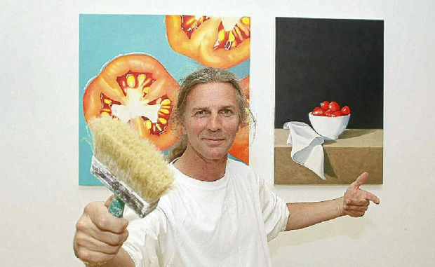 DELICIOUS: Artist Will Irving with some of the paintings featuring in his exhibition.