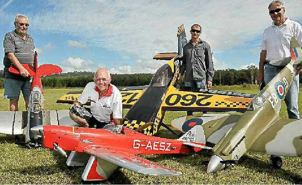 Suncoast Model Flyers (from left) Bryan Cooper, Roy Salmon, Byron Webb and Roy Dixon prepare for an air show this Sunday.