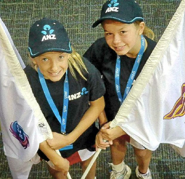Eleanor Edwardsson and Geogia Laird were flag bearers for the Queensland Firebirds.