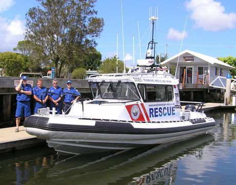 Wooli Marine Rescue members (from left) Steve Reading, David Richardson, Bob Stack and unit commander Richard Taffs take delivery of the new rescue vessel at Yamba.