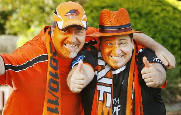 Local Roar fans Tony (left) and Rob Scarcella will be behind their team in the A-League Grand Final.