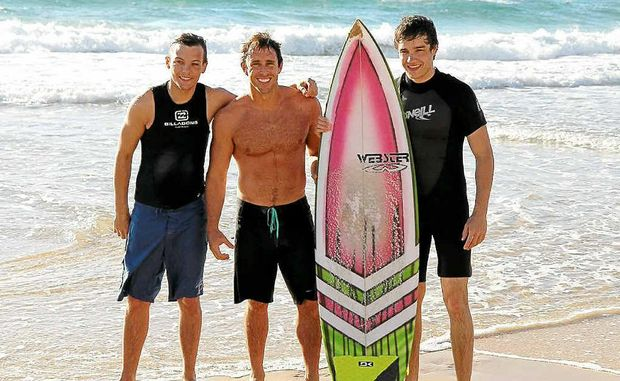 Liam Payne (left) from One Direction endorsed a Webster board after an early morning surf at Wurtulla.