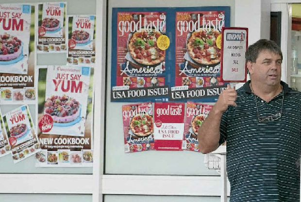 """South St Newsagency owner Robert """"Rowdy"""" Reid talks to police after his business was robbed on Wednesday, January 18."""