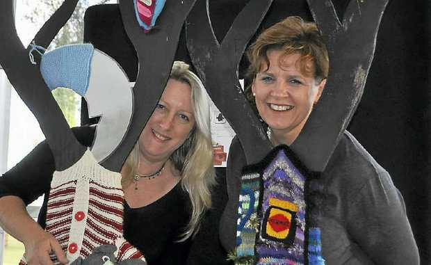 Jumpers and Jazz in July organisers Karina Devine and Tracy Vellacott get in the spirit of the festival with the display at the Warwick Art Gallery.
