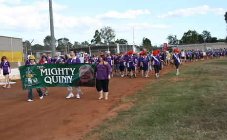 Relay teams line the track behind the Mighty Quinn team as the 18 hour long Relay for Life gets underway.