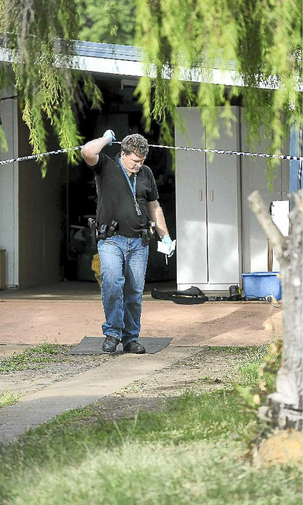 Police search a Kalkie house after finding what is believed to be an illegal drug lab.
